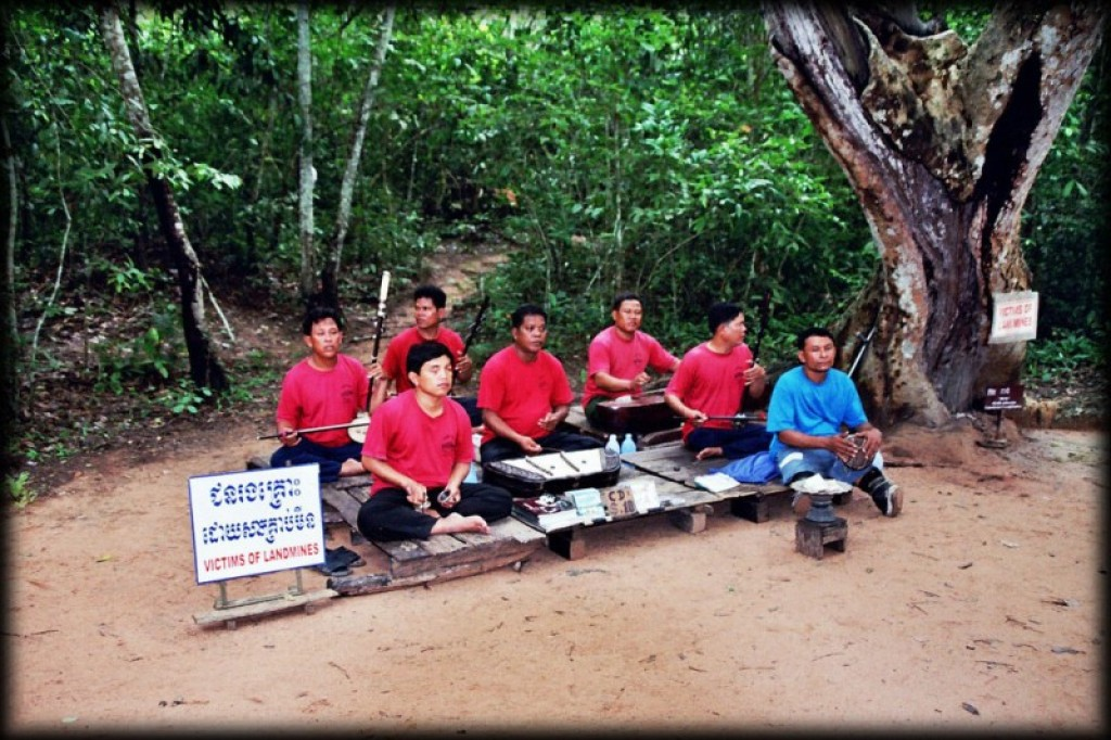 A group of landmine victims plays music at the entrance to the site.  Almost all the temples had similar groups.  Over 25 years of civil war has left Cambodia with 6-10 million anti-personnel mines and 500,000 tons of unexploded ordinance that the US dropped during the Vietnam War (aka the American War, as it's known in Vietnam).  1 in 236 Cambodians has lost a limb due to a mine explosion.  It's heartbreaking how many people you see with these injuries.
