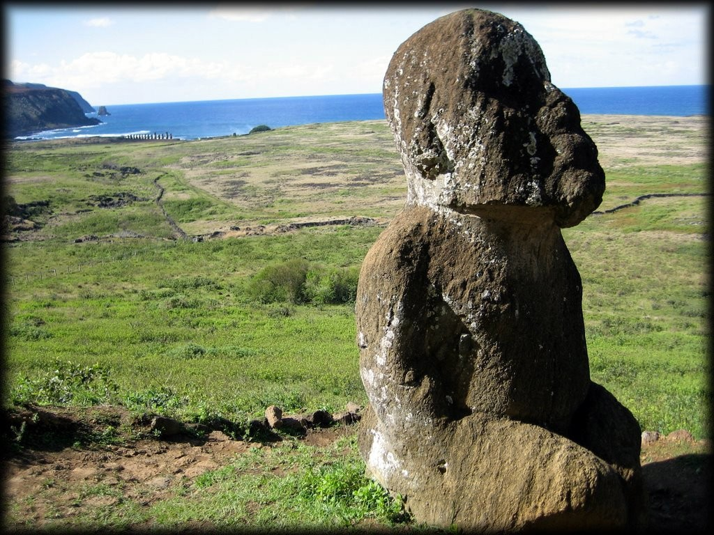 Moai Tukuturi with Moai Tongariki in the background.