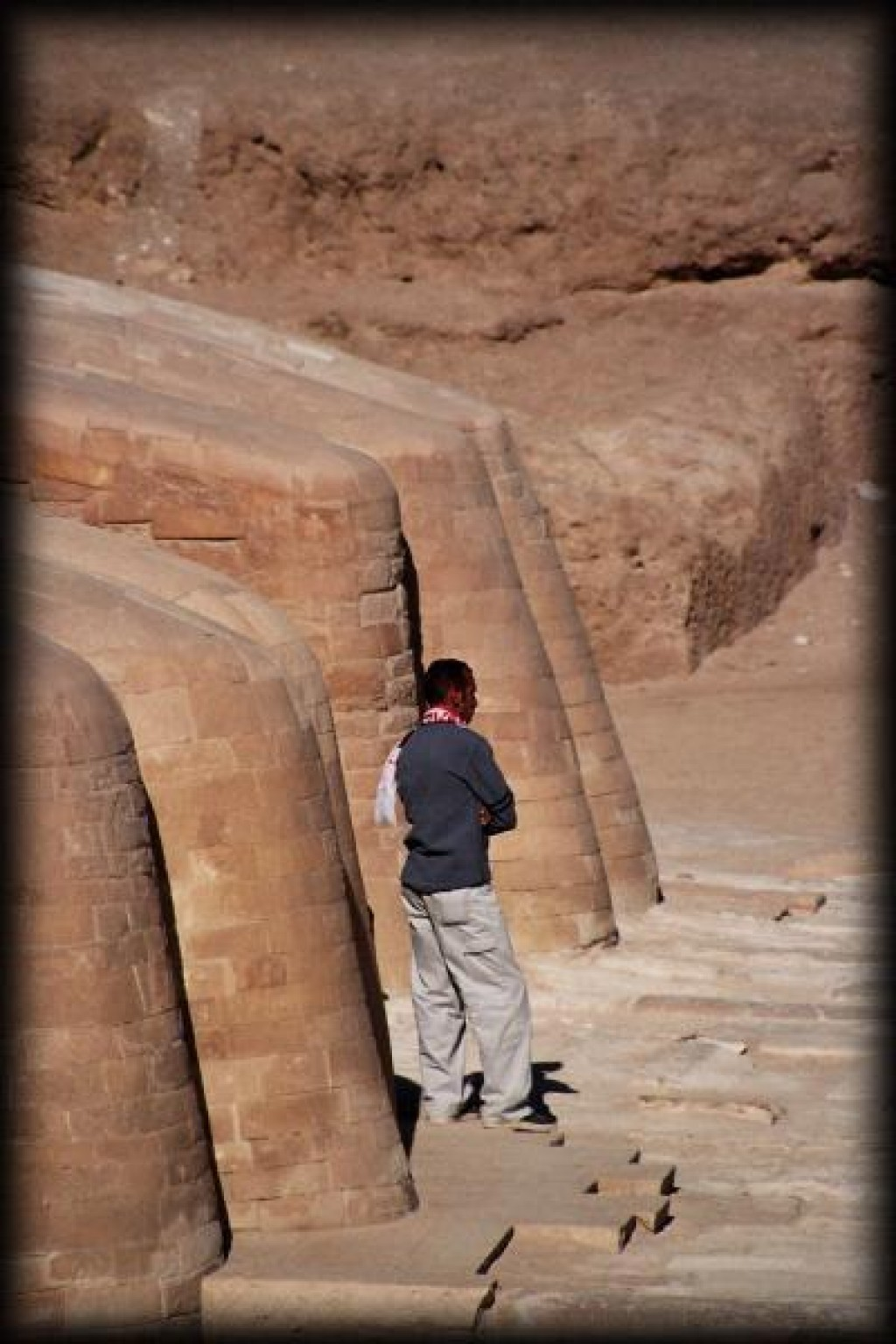 This maintenance worker is standing at the Sphinx's feet.