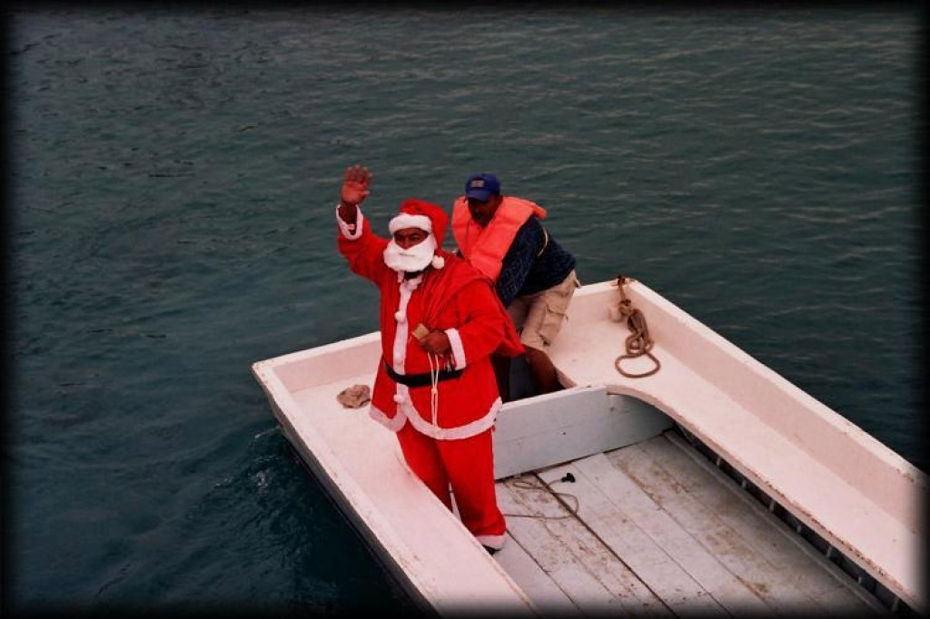 Anyways, the other reason we were there was to do some snorkeling in the Red Sea.  Speaking of Red, here's Santa waving us off on our dive boat.  You could get your photo taken with him, and they would sell it to you for a good price, my friend.
