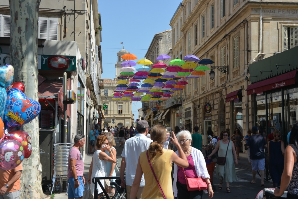 Hundreds of umbrellas above Rue Jean Jaures in Arles, Provence