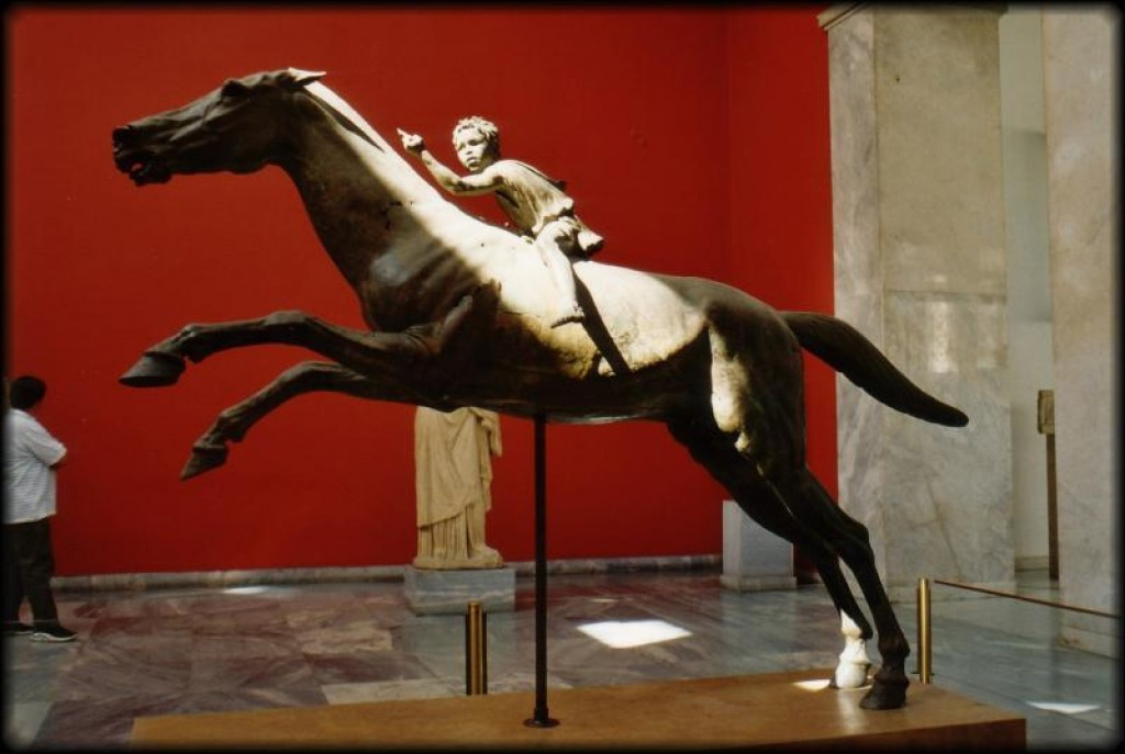 The bronze jockey of Artemision.  The statue represents a young man riding a horse. He probably held the reins in his left hand and a whip in the right. It was found in pieces, in the area of a shipwreck off the cape Artemision, in north Euboea. Dated to ca. 140 B.C.