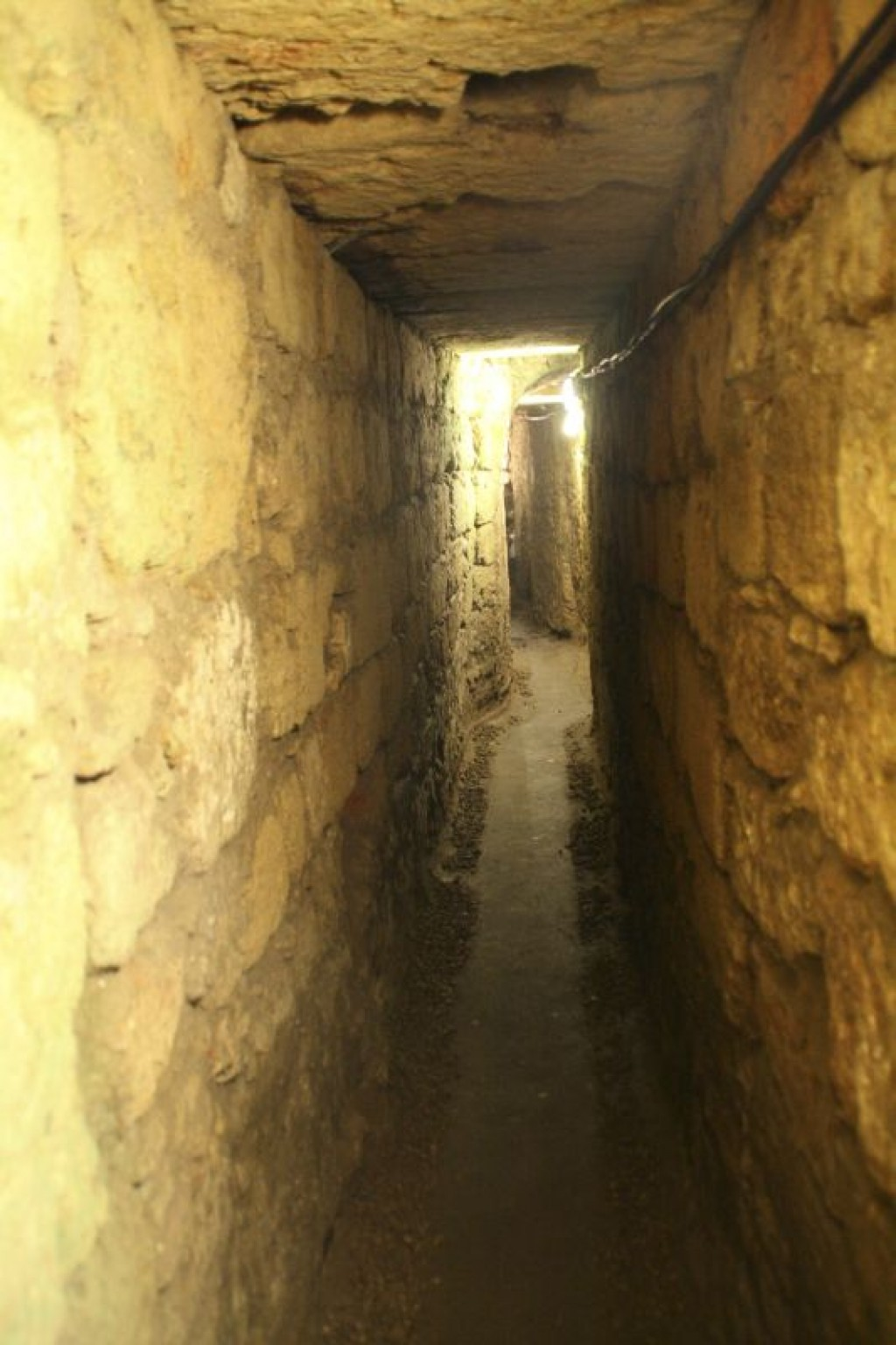 Tunnel underneath the old city leading to a tombstone of the last bishop of Nazareth.