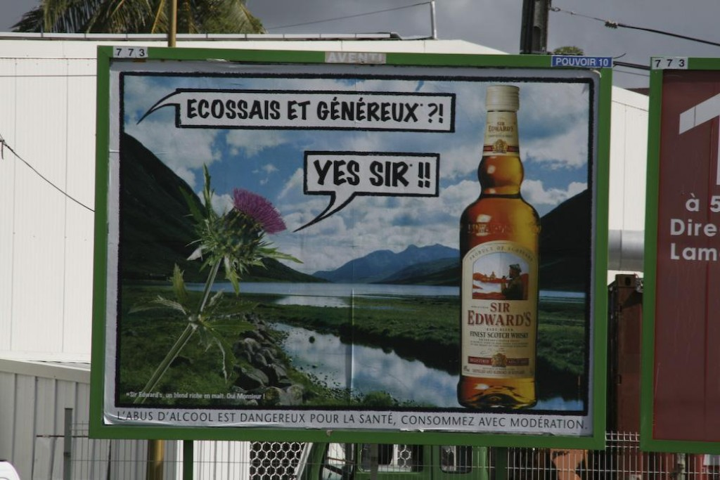 'Scottish and generous??? Yes Sir!' roadside ad for Sir Edward's Scotch Whisky.  Obviously Martinique truly is a slice of France in the Caribbean.