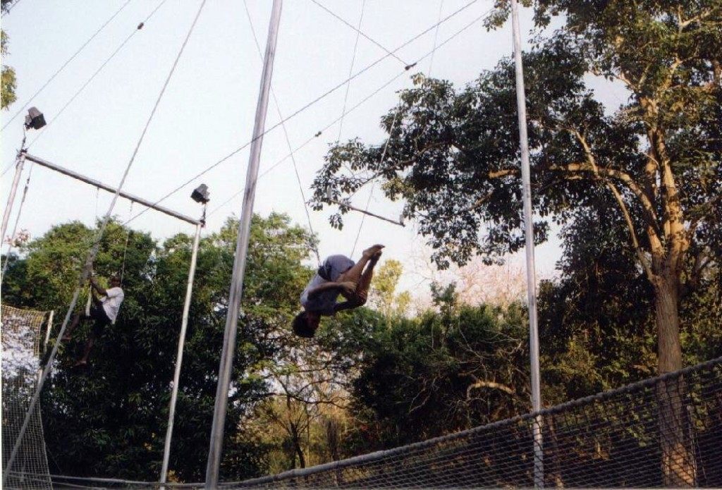 Ian in the middle of doing his backflip dismount from the trapeze.  Notice how there's no picture of Wendy's dismount...