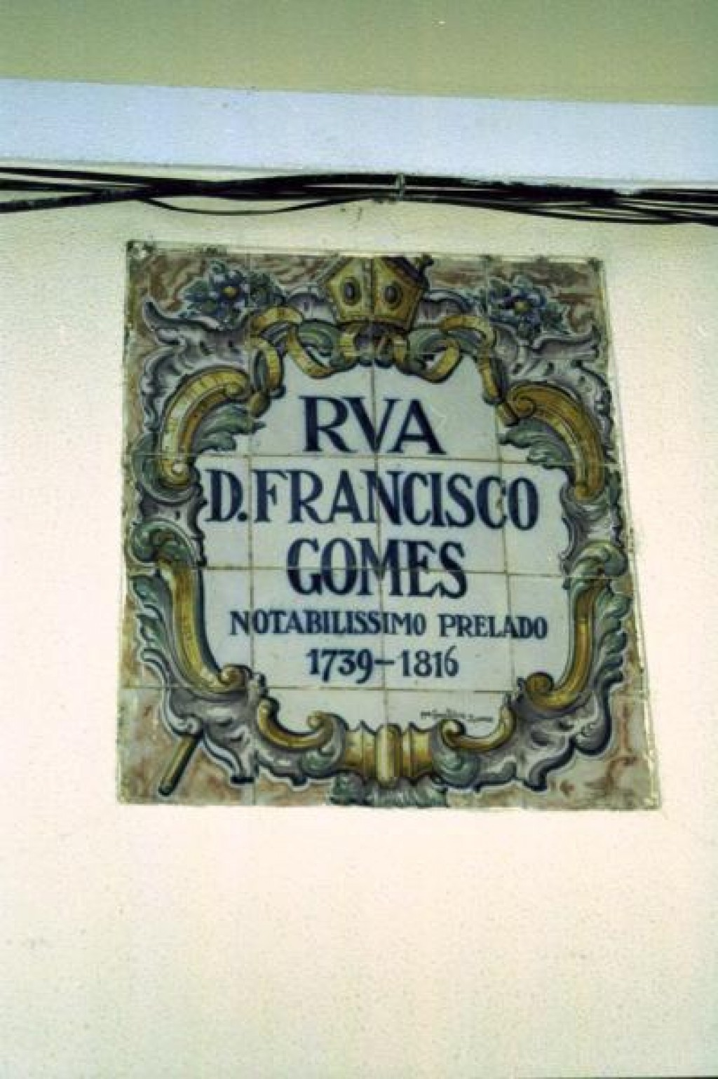A street sign in the historic district.  Tiles are everywhere in Portugal.