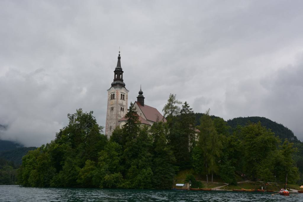 In the middle of the lake, the famous Church of the Assumption can be reached by renting a spot on a traditional boat (Pletna)