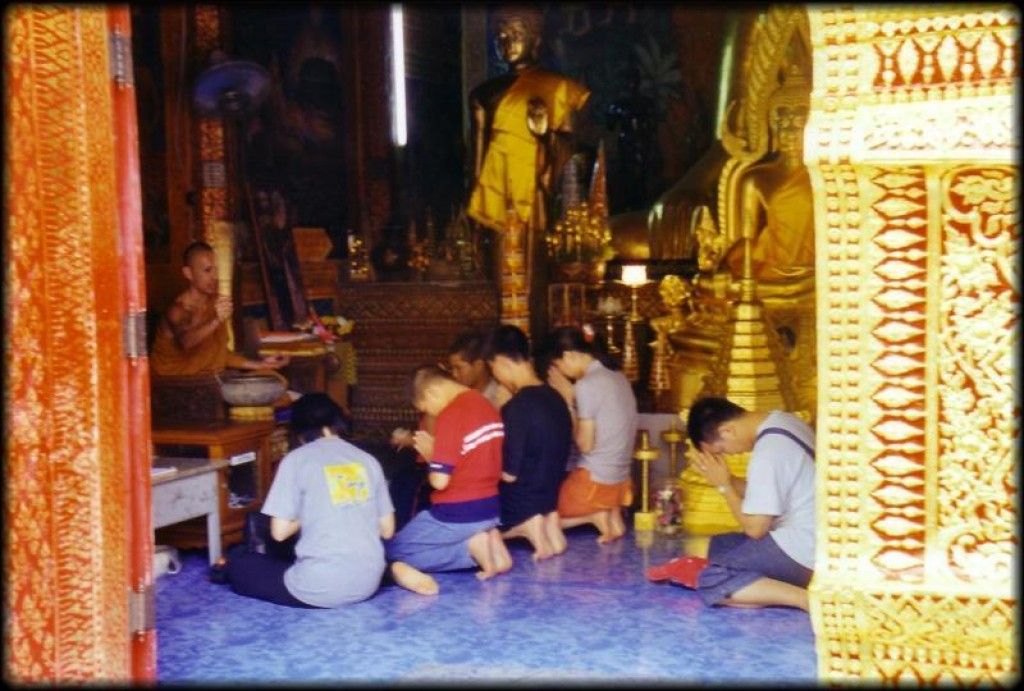 Here is a monk blessing a group of Thai worshippers.  After telling us to come over and sit in front of him (in perfect English, no less), he then blessed us!  Sadly, we found out later that the blessings couldn't compete with the concentration of bacteria in Malaysian food.