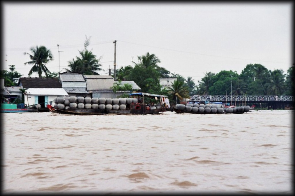We took the 'bus' south to Can Tho, to see the floating market.  We're sure it used to be a bus in the 1960's.