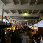 Part of the Saturday Market is under a bridge