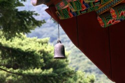 Bell hanging from one of the temple buildings.