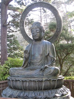 Buddha contemplates the zen tranquility of the Japanese Tea Garden, Golden Gate Park, San Francisco