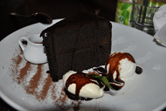 "About to enjoy ""Aztec Treasure"" - a heavenly slice of super-rich chocolate cake at The Flying Burrito Brothers restaurant in Christchurch, New Zealand.  Notice how we forgot to photograph our dinners, but this masterpiece we definitely remembered to record! ;)"