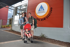 The three of us in front of our first hostel in Rotorua, New Zealand.  Diaper backpack on front, backpack with Phil&Teds Traveler and everything else on back, baby in the UppaBaby G-Lite and we're ready to go!