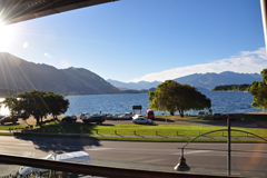 The balcony of The Reef Seafood Restaurant & Bar frames the beautiful view of Lake Wanaka