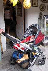 Facing backward in the seat of the UPPAbaby Vista.  Notice all the stuff we've managed to shove into the basket!
