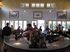 The bar in the Duckhorn Vineyards Estate Winery tasting room is ringed with tables and flooded with natural light from its many windows.  The views out over the winery are beautiful.  Unfortunately they don't make up for the quality of the wine.