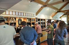 Plenty of room for wine tasting at the cellar door bar, Gibbston Winery, Central Otago.