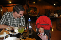 Relaxing after dinner in her UppaBaby GLite which is doing its usual double duty as a travel highchair.