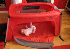 Checking out the Phil & Ted's Travel Cot for the first time.  It's gotten a LOT of use since then!