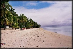 Aitutaki offers unspoiled beaches fringing a shallow turquoise lagoon.