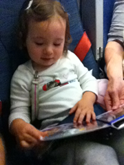 "Two years later, and still absorbed in her Sassy photo book.  Truly a great travel toy that will ""grow"" with your child!"