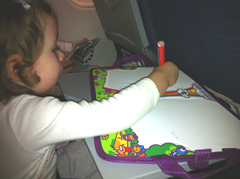 Keeping busy on the flight with the Travel Aquadoodle - a great toddler travel toy!