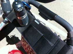 The UPPAbaby Vista Parent Organizer fits a thermos water bottle and the middle pocket is the perfect size for an iPhone.