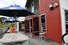Outdoor seating on the deck at Morepark Cafe, Waitomo