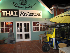 A tuk tuk on the front patio welcomes you to Sawasdee Thai Restaurant, a couple of blocks from the highrise strip in Aruba.
