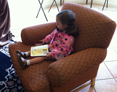 Relaxing at a winery with some of her Indestructibles books.  Washable and super durable, these make a great toddler travel toy, at home or on the road.